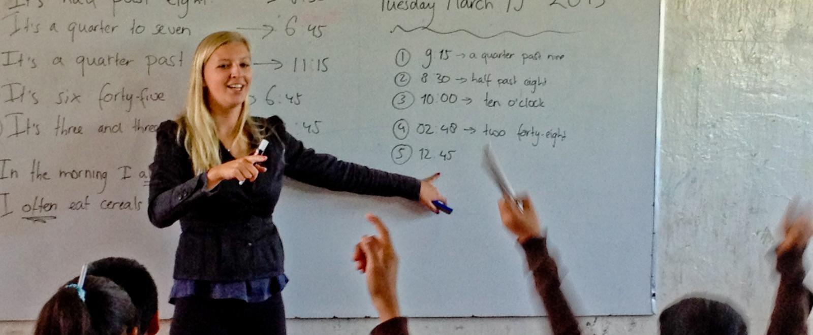 Children learn how to tell the time from a volunteer teaching in Mexico